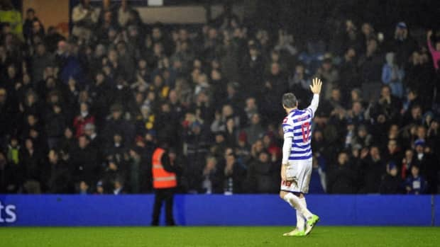 Queens Park Rangers defender Ryan Nelsen waves to the fans after his playing his final game Tuesday, a 0-0 English Premier League draw with Manchester City. Nelsen is taking over as head coach of Major League Soccer's Toronto FC.