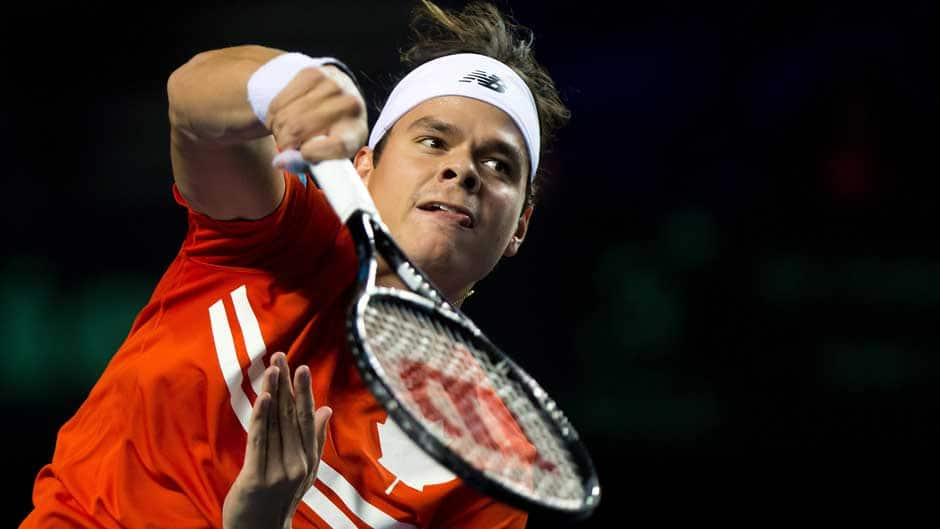 Canada's Milos Raonic smashes the ball over the net for a point against Spain's Guillermo Garcia-Lopez during their Davis Cup tennis world group first-round tie singles match in Vancouver, B.C., on Sunday.