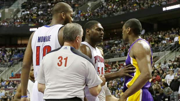 Detroit Pistons forward Jason Maxiell (54) and teammates confront Los Angeles Lakers forward Metta World Peace after his flagrant foul on Pistons guard Brandon Knight during the first quarter Sunday.
