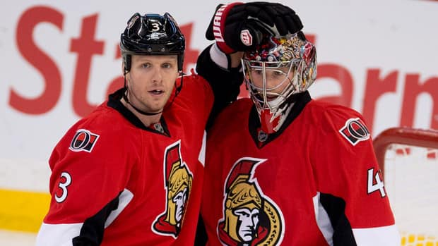 Ottawa Senators defenceman Marc Methot, left, congratulates goalie Craig Anderson after the Senators defeated the Buffalo Sabres 4-3 on Tuesday at home.