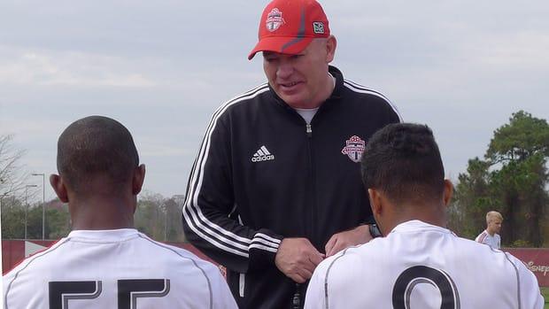 Toronto assistant coach Fran O'Leary talks with players at a Toronto FC training session.
