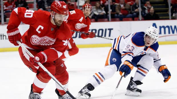 Detroit Red Wings centre Henrik Zetterberg (40) keeps the puck away from Edmonton Oilers centre Ryan Nugent-Hopkins (93) on Saturday in Detroit.