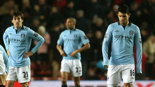 David Silva, left, and Sergio Aguero of Manchester City look dejected after conceding a third goal to Southampton at St Mary's Stadium on February 9, 2013.