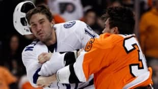 Philadelphia Flyers' Zac Rinaldo, right, lands a punch that knocks the helmet off of Tampa Bay Lightning' B.J. Crombeen during a fight in the first period on Tuesday. A later hit, while Crombeen was falling, landed Rinaldo in some controversy.