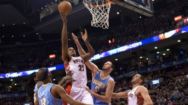 Toronto Raptors' Rudy Gay, centre, scores on Denver Nuggets' Corey Brewer, left, and Kosta Koufos in Toronto on Tuesday night.
