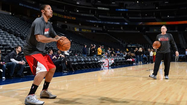 Derrick Rose of the Chicago Bulls practices before a game against the Denver Nuggets on February 7, 2013.
