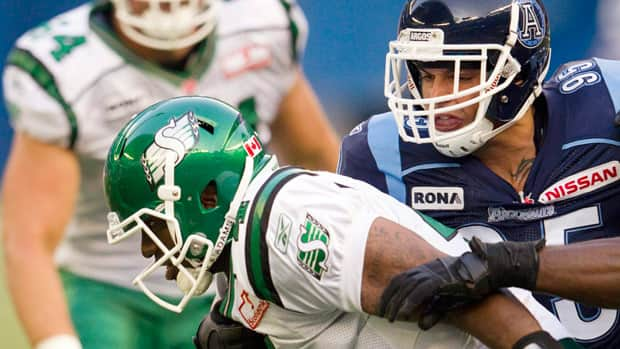 Ricky Foley, seen in 2011 sacking Saskatchewan quarterback Darian Durant, now joins the Roughriders.