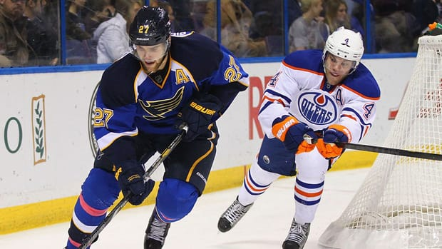Alex Pietrangelo of the St. Louis Blues, left, controls the puck against Taylor Hall of the Edmonton Oilers on March 1, 2013 in St. Louis, Missouri.