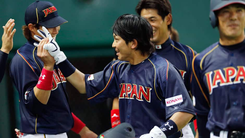 Japan's third baseman Nobuhiro Matsuda, center, celebrates with teammates after hitting an RBI single off Brazil's pitcher Kesley Kondo in the eighth inning of their World Baseball Classic first round game in Fukuoka, Japan on Saturday.