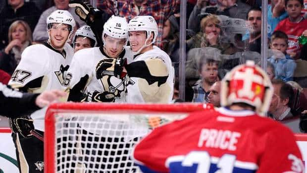 Brandon Sutter (16) of the Pittsburgh Penguins celebrates his first-period goal with teammates against the Montreal Canadiens at the Bell Centre on Saturday in Montreal.