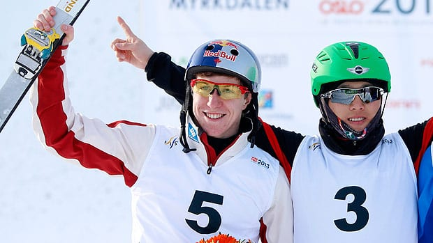 Travis Gerrits of Canada, left, shares the podium with winner Qi Guangpu of China in Norway on Thursday.