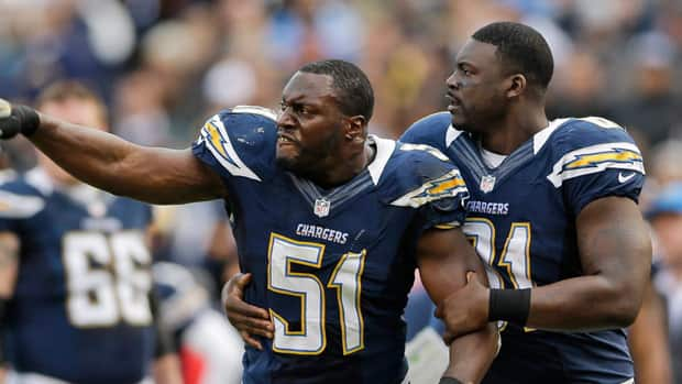 Takeo Spikes, centre, is seen getting tossed from his final regular season games for San Diego.