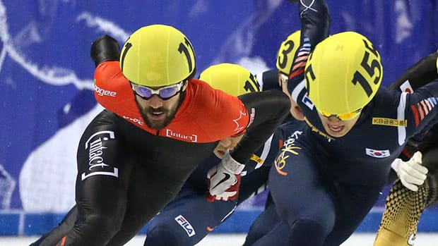Canadian Charles Hamelin, left, battles for position with Korean Sin Da-Woon on Friday.