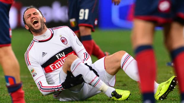 AC Milan's Giampaolo Pazzini reacts after getting hurt against Genoa on Friday.