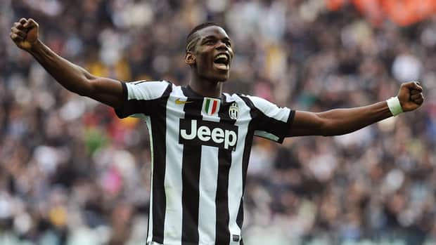 Juventus' Paul Pogba celebrates teammate Emanuele Giaccherini's goal against Catania.
