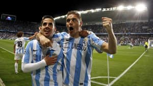 Malaga's Isco Alarcon, left, celebrates with teammate Joaquin Sanchez after scoring against FC Porto during the Champions League round of 16 second leg against FC Porto at Rosaleda stadium in Malaga, Spain on Wednesday.