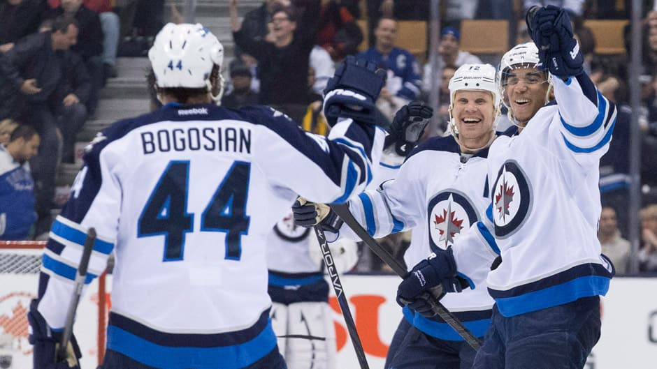 Winnipeg Jets defenceman Zach Bogosian (44) celebrates his shootout goal with teammates Evander Kane, right, and Olli Jokinen, back, Saturday night against the Toronto Maple Leafs.