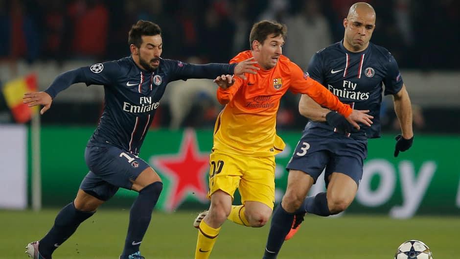 Barcelona's Lionel Messi, centre, escapes Paris Saint Germain's Ezequiel Lavezzi, left, and Alex, during their UEFA Champions League quarter-final first leg at Parc des Princes stadium in Paris on Tuesday.