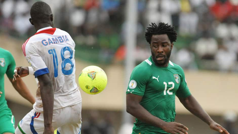 Ivory Coast's Wilfired Bony, right, vies for the ball with Gambia's Omar Colley, left, during a World Cup 2014 qualifying match on Saturday.