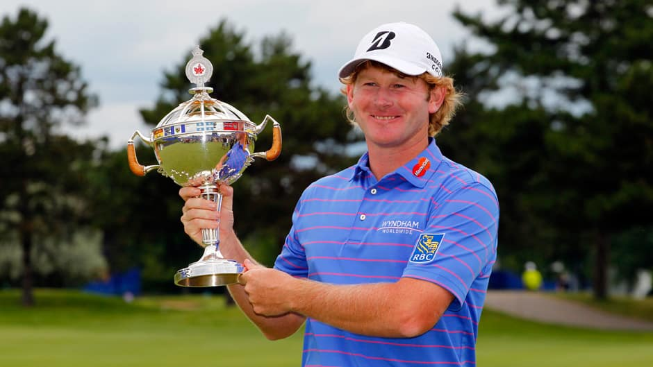 Brandt Snedeker holds the championship trophy after winning the RBC Canadian Open at Glen Abby Golf Club on July 28, 2013 in Oakville, Ontario.
