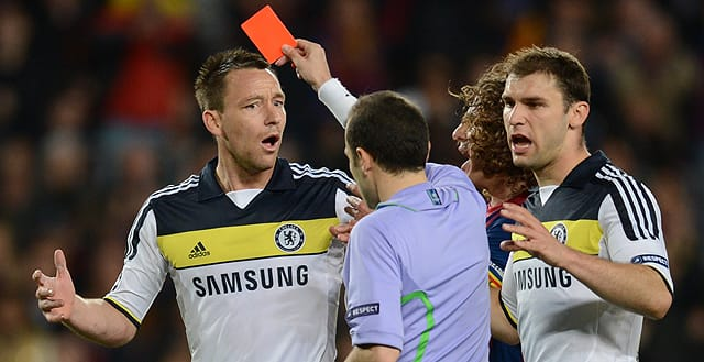 Chelsea's defender John Terry receives a red card from Turkish referee Cuneyt Cakir during the UEFA Champions League second leg semi-final.