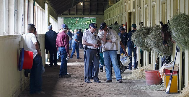 Security and barn personel stand in the shed row after all of the Belmont horses moved into the detention barn in preparation for the 144th Belmont Stakes.