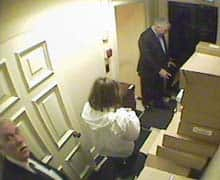 Security cameras at 10 Toronto St. show Conrad Black, right, his assistant Joan Maida, centre, and chauffeur John Hillier inside the Hollinger Inc. office on Friday, May 20, 2005. (Courtesy: Toronto Star)