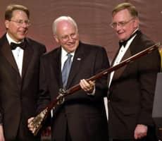 U.S. Vice-President Dick Cheney accepts a rifle from National Rifle Association officials