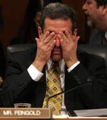 Sen. Russell Feingold rubs his eyes during the confirmation hearings for Supreme Court nominee Samuel Alito, Tuesday, Jan. 10, 2006. (AP file photo)