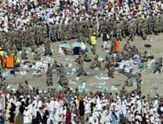 Saudi%20paramedics%20tend%20to%20wounded%20as%20Saudi%20security%20forces%20organize%20Muslim%20pilgrims%20stoning%20a%20pillar%20representing%20the%20devil,%20Jan.%2012.%20%28Photo:%20Muhannad%20Falaah/Getty%20Images%29