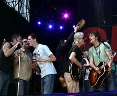 Members of the Barenaked Ladies and Blue Rodeo in Live 8 finale in Barrie, Ont. (CBC.ca image)