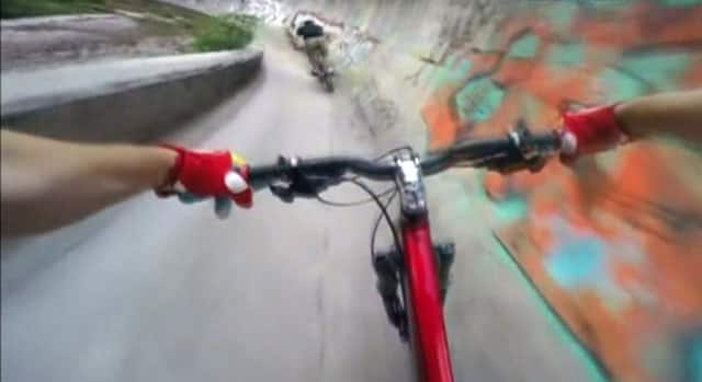 World - Daredevil cyclists ride down bobsled track