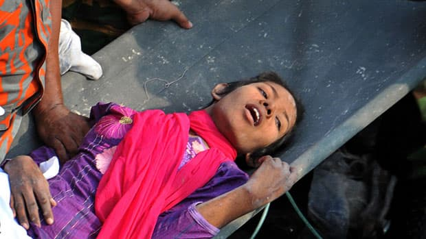 News - Bangladesh rescuers free woman