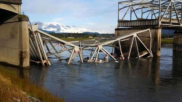 A Washington state bridge collapses, dumping two vehicles into the water north of Seattle
