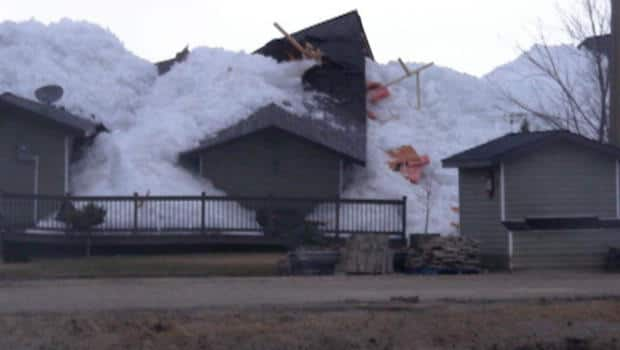 Weather - Ice wall crushes homes in Manitoba