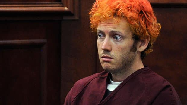 Colorado shooting suspect James Holmes made his first court appearance on Monday, while a vigil was held for the victims of the mass shooting