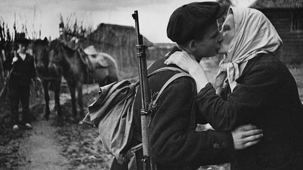A Russian son kissing his mother goodbye as he leaves to join a guerilla detachment to fight for the liberation of their land from the Nazi invaders. Original Publication: (Photo by Hulton Archive/Getty Images)