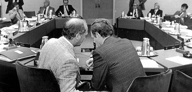 Prime Minister Pierre Trudeau talks with Justice Minister Jean Chrétien as they wait for the premiers to take their places during the ConstitutionaI Conference, Nov. 4, 1981.