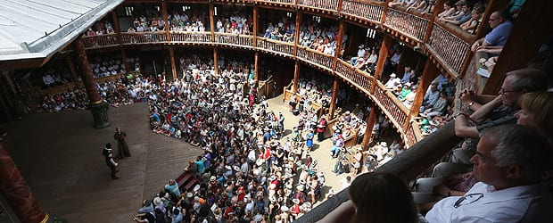 Audience members watch a production of 'A Midsummer Night's Dream' in Shakespeare's Globe theatre on the Southbank of the River Thames in London, England. (Photo by Oli Scarff/Getty Images)