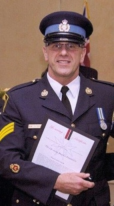 Sgt Kent Taylor with OPP Commissioner Chris Lewis.jpg