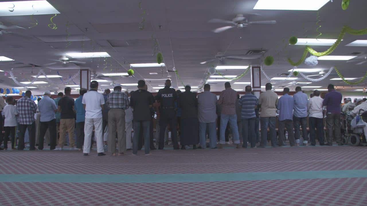 Officers from the Somali Unit join prayers at a Rexdale, ON mosque. (Photo courtesy: Keeping Canada Safe)