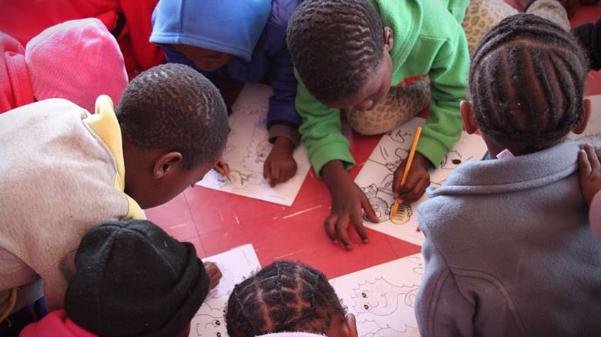 Kids colouring together.