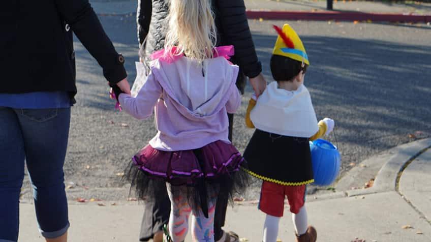 Kids trick-or-treating on Halloween night.