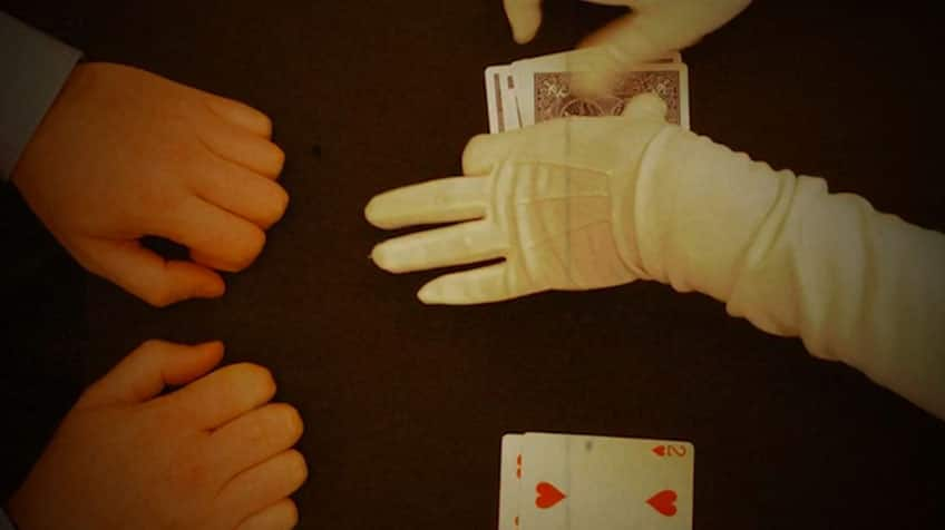 Magician hand combines two untouched piles together.