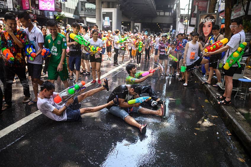 the streets of bangkok are soaked after water fights for Songkran