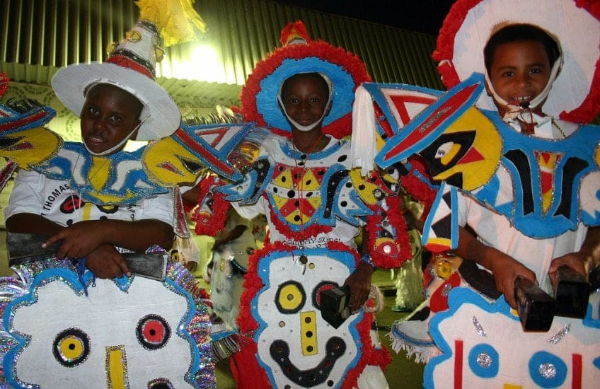 Children dressed in fancy costumes and hats to celebrate Junkanoo