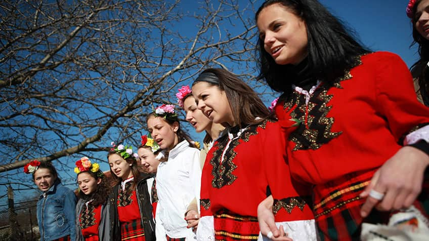 Bulgarian women are dressed up in traditional clothing to celebrate Palm Sunday.