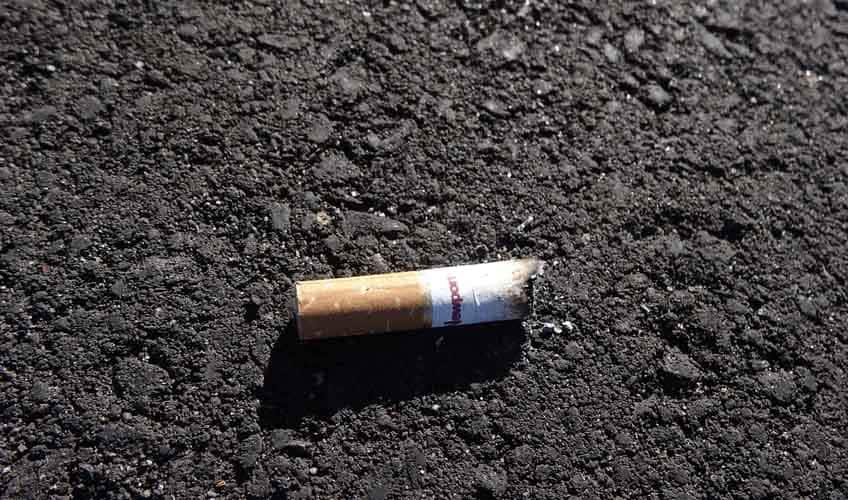 A cigarette butt on the ground