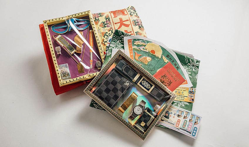 Paper sculptures of fancy items like designer accessories.