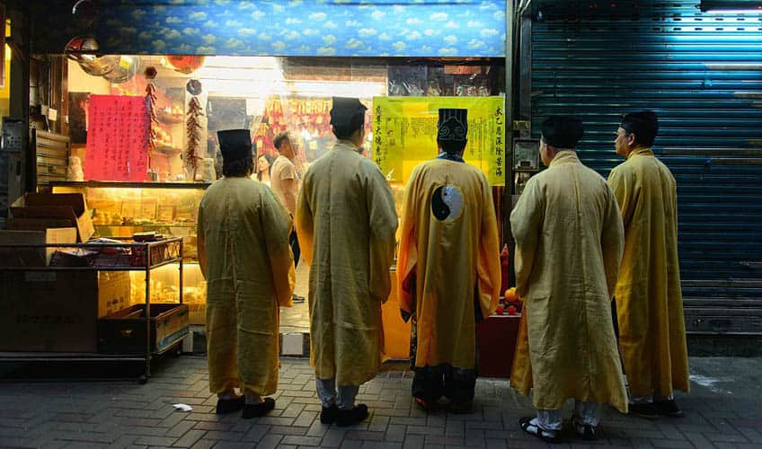 Taoist monks performing a ritual during the festival.